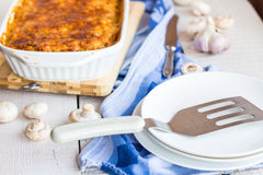 Fed meat lasagna dish on belots Royalty Free Stock Photos