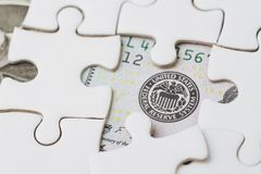 FED strategy of interest rate hike, United States of America financial or economics concept, jigsaw or puzzle reveals US Federal. Reserve emblem on US dollar stock images