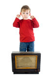 Fed Up. A metaphorical image of a little boy fed up with old music blurting from a vintage radio, isolated on a white background stock photography