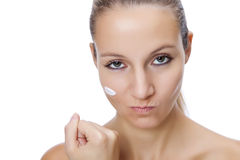 Fed up with applying moisturizing cream Royalty Free Stock Photos