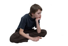 Fed-up boy. A young boy looking bored and fed up Stock Photography