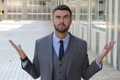 Fed up businessman asking for a break.  stock image