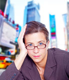 Fed-up businesswoman. Depressed businesswoman against Times Square, New York background Royalty Free Stock Images