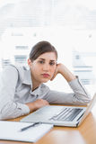 Fed up businesswoman looking at camera Royalty Free Stock Photography
