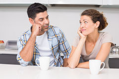Fed up couple having coffee looking at each other Stock Photo