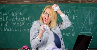 Fed up of fails. Trial and error is fundamental method of problem solving. Woman teacher holds crumpled pieces of paper. Teacher screaming face holds pieces of royalty free stock image