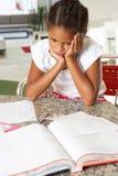Fed Up Girl Doing Homework Arkivbilder
