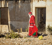 Fed up  Santa. A fed up  Santa trudging along with his sack Royalty Free Stock Image