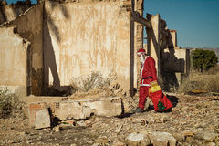 Fed up Santa. A fed up Santa trudging along with his sack royalty free stock photo