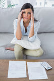 Fed up woman checking her bills Royalty Free Stock Photography