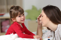 Fed up woman and toddler crying royalty free stock photo