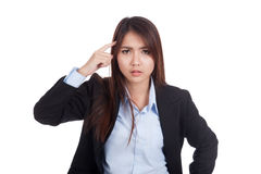 Fed up young Asian businesswoman point to her head Royalty Free Stock Photos