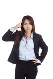 Fed up young Asian businesswoman point to her head Royalty Free Stock Images