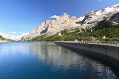 Fedaia lake and Marmolada glacier Royalty Free Stock Image