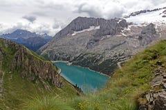 Fedaia lake and Marmolada glacier Royalty Free Stock Image