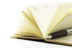 Feder auf Notizbuch Lizenzfreies Stockbild