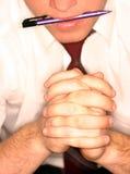 Feder in der Hand Stockfoto