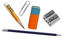 Feder, Radiergummi-, Papierklammer und Bleistiftspitzer Lizenzfreies Stockbild