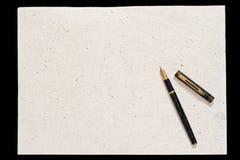 Feder und altes Papier Lizenzfreies Stockfoto