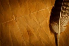 feder auf einem alten papier stockfotos bild 9943303. Black Bedroom Furniture Sets. Home Design Ideas