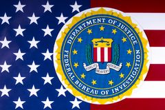 Federal Bureau of Investigation. LONDON, UK - MARCH 26TH 2018: The seal or symbol of the Federal Bureau of Investigation, portrayed with the US flag, on 26th Royalty Free Stock Images