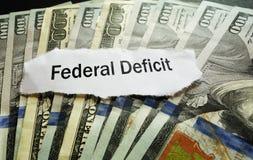 Federal Deficit news headline. Federal Deficit newspaper headline on hundred dollar bills Stock Photography
