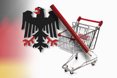 Federal eagle, red pencil and shopping cart against german flag Royalty Free Stock Photo