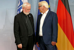 Federal Foreign Minister Dr Frank-Walter Steinmeier welcomes Archbishop Paul Galagher Royalty Free Stock Image