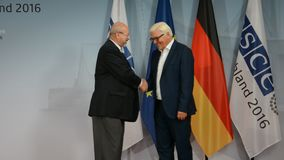 Federal Foreign Minister Dr Frank-Walter Steinmeier welcomes Lamberto Zannier. POTSDAM, GERMANY. SEPTEMBER 1ST, 2016: Federal Foreign Minister Dr Frank-Walter stock video footage