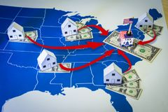 The federal government of EE. UU increasing taxes to families. Family houses with dollar bills and central goverment tax over a US map.USA finance, increasing Royalty Free Stock Images