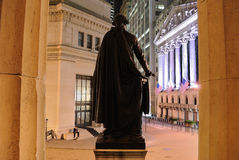 Federal Hall. Looking between the columns of Federal Hall to view the corner of Broad Street and Wall Street in New York City. On the right stands the New York royalty free stock image