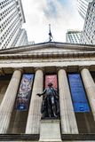 Federal Hall National Memorial in New York City, USA. New York City, USA - August 1, 2018: Facade of the Federal Hall National Memorial and the statue of George stock photography