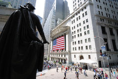 Federal Hall and Wall Street. A view from Federal Hall behind a Statue of George Washington looking towards the Stock Exchange on Wall Street. Federal Hall was royalty free stock photography