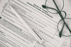 Federal income tax laws W9 form Royalty Free Stock Image