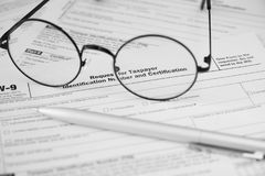 Federal income tax laws W9 form Stock Images