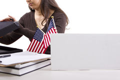 Federal Job. State or Federal female worker with a blank sign on her desk Stock Photography