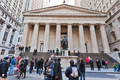Federal National Hall Memorial New York City. Tourists at the facade of the Federal National Hall Memorial with its temple form with columns and the statue of stock photography