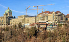 Federal Palace of Switzerland and Hotel Bellevue buildings in Be. Bern, Switzerland - 29 December, 2015: view from Kornhausbruecke bridge with the Federal Palace stock photos