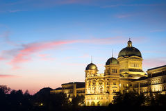Federal Palace of Switzerland at night. The Federal Palace of Switzerland (Bundeshaus) with red clouds, side view shot  after sunset Royalty Free Stock Photography