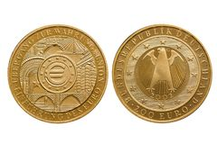 Federal Republic of Germany 200 Euro gold coin Monetary Union 2002. Front side Euro sign, back eagle stock photos
