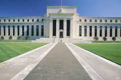 Federal Reserve Bank. Also known as The Fed where they make monetary policy. Its Federal Chairman is Alan Greenspan. It is an all white building with a green stock photo
