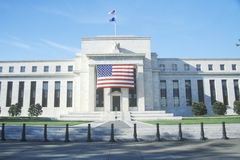 The Federal Reserve Bank. American Flag hung on The Federal Reserve Bank, Washington, D.C royalty free stock photos