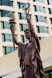 Federal Reserve Bank Statues in Kansas City. Landmark Statues located outside the Federal Reserve Bank of Kansas City. Modern architecture building in urban city royalty free stock photography