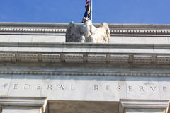 Federal Reserve building in Washington DC, US. Close up of a top part of the building with eagle statue Stock Image