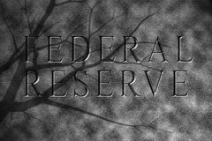 Federal reserve in granite stone. Federal reserve of america text in granite stone showing bleak future Royalty Free Stock Image