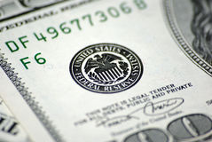 Federal Reserve System on dollar banknote. United States Federal Reserve System (FRS) stamp on one hundred dollar banknote. Closeup Royalty Free Stock Photos