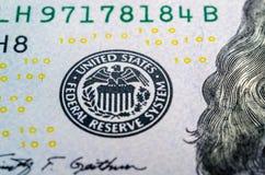Federal reserve system symbol on hundred dollar bill closeup mac Royalty Free Stock Image