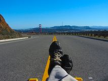 Federal Shutdown Chllin at the Golden Gate. Laying in the middle of the road since cars were banned from the Golden Gate Recreational Area due to the Federal Royalty Free Stock Images