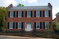 Federal Style Home. Red brick Federal style home, Very symmetrical design Royalty Free Stock Images