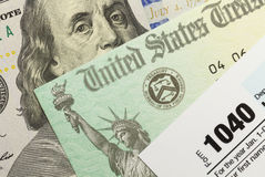 Federal Taxes. 1040 Tax Form with Refund Check and Cash Stock Photo